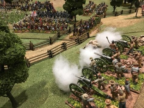 Three cannons belching smoke
