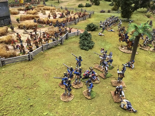 Soldiers in blue uniforms shooting at soldiers in red behind a fence