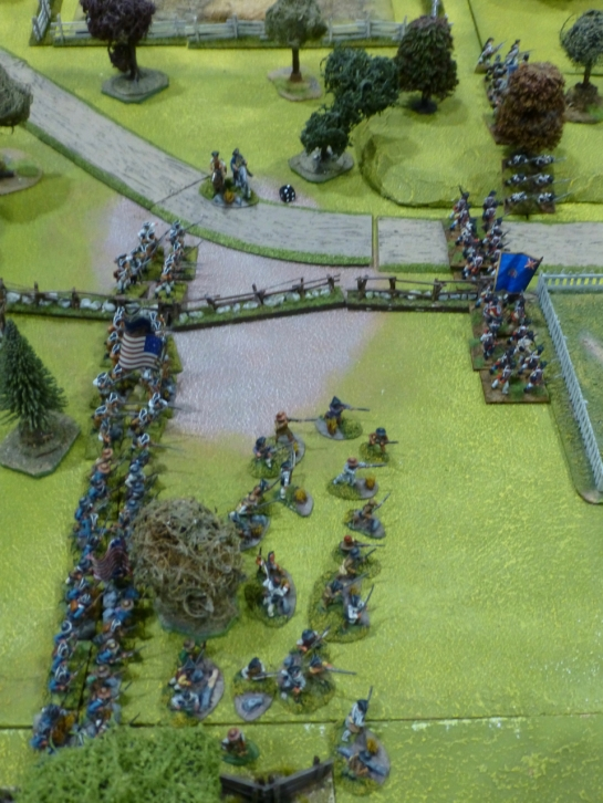 Lines of troops advancing over green fields