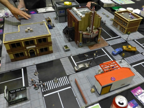 Urban streets and building with small gangs of miniatures