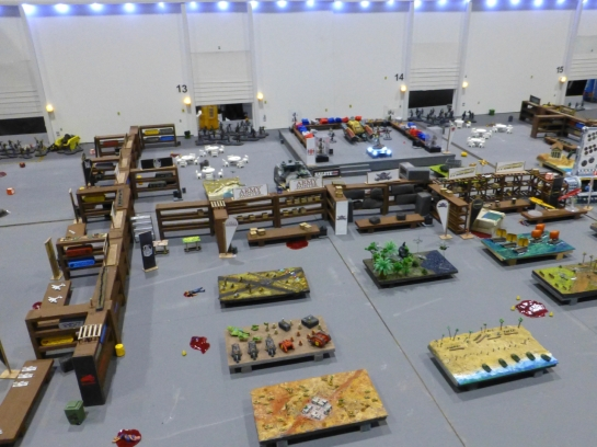 Small scale models of gaming tables and miniature trading stands in a large exhibition hall