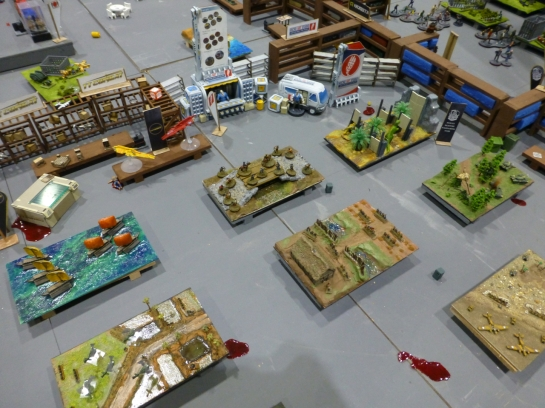 Several scale models of gaming tables with a mix of settings