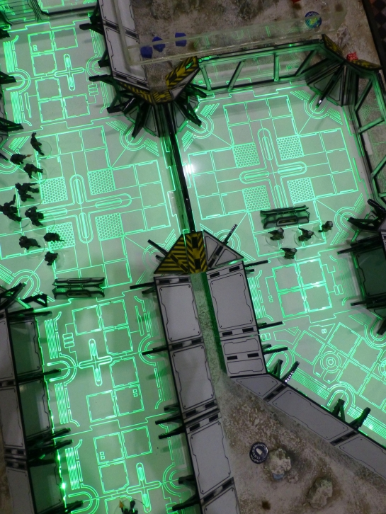 Top down view of a green illuminated floor reminiscent of computer circuits