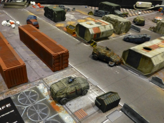 Armoured fighting vehicles amongst industrial terrain