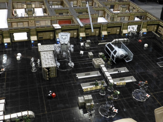 Hangar bay with black floor, stormtroopers, AT-ST and TIE fighter
