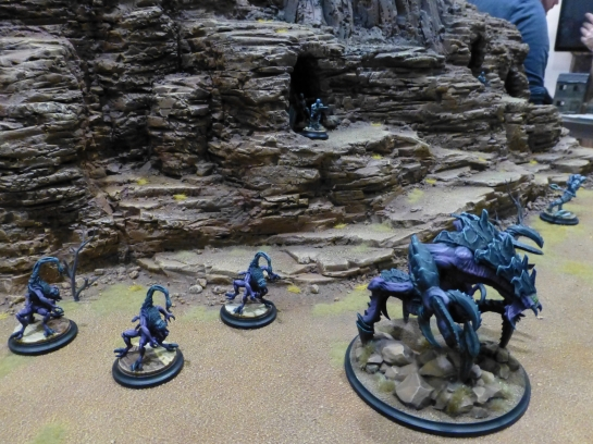 Rugged mountainside with arachnid blue monsters