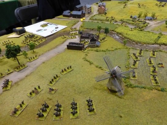 Cavalry and infantry advancing over open fields with a windmill in the foreground