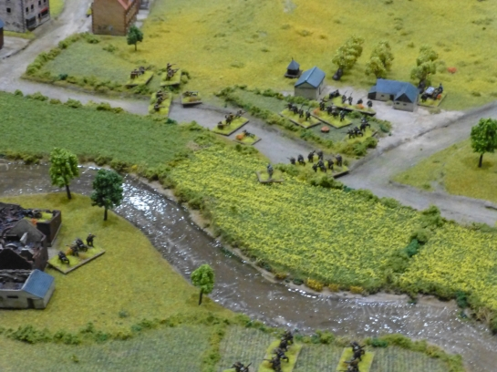 A river running through fields with farmsteads occupied by soldiers