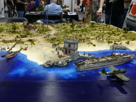 Coastline with a warship, fighter plane and infantry making landfall