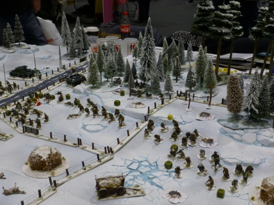 Infantry advancing from woods into open fields covered in snow