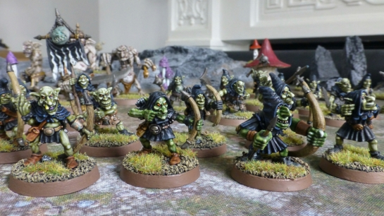 Group of goblin archers wearing black hooded tunics