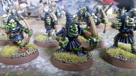 Night Goblin archers aiming and loading their bows