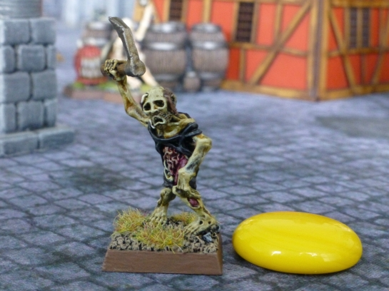 A zombie standing next to a yellow glass token