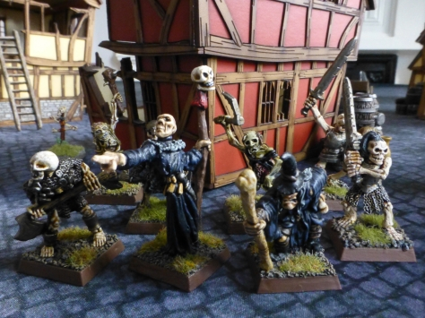 Skeletons, zombies and wizards on a cobblestoned street