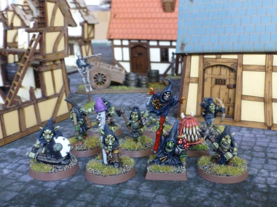 Band of Goblins amidst medieval houses
