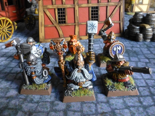 Group of six Dwarfs in a medieval city