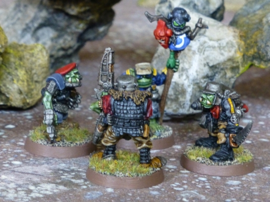 Four Space Orks standing in a circle