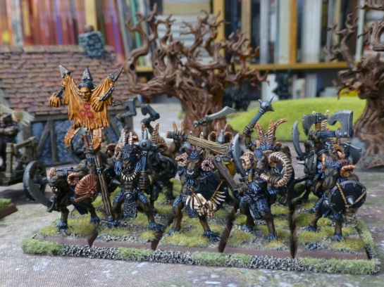 Twenty strong unit of beastmen with horns carrying hand weapons and shields