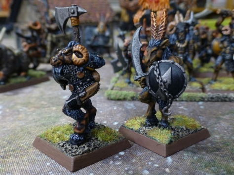 Two beastmen armed with axe, curved sword and shields