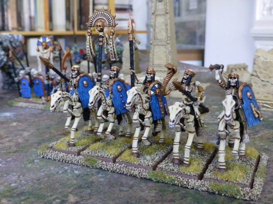 Five skeletons carrying blue shields and spears on skeletal horses