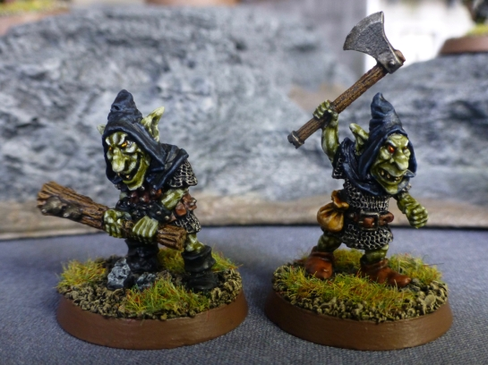 A goblins with a double handed spiked club and another with an axe