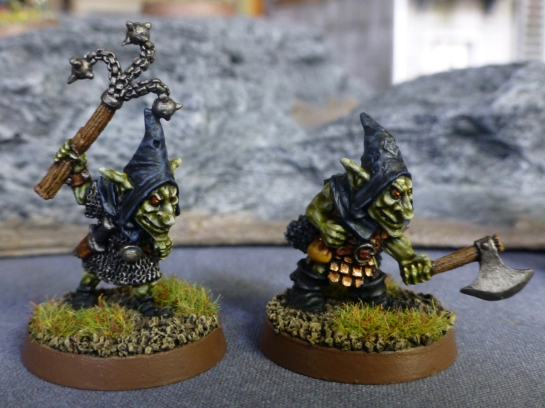 Two goblins wielding a flail and axe respectively