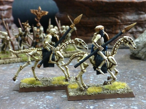Two skeletal riders carrying bronze tipped spears