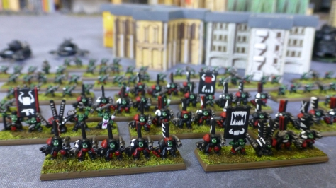 Several bases of 6mm scale Space Orks in power armour