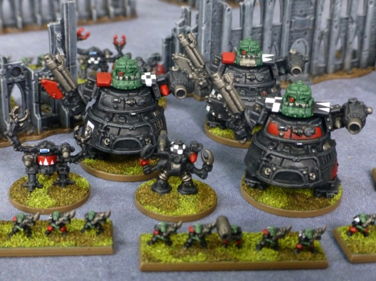 Space Ork Goff infantry in front of Dreadnought and Stompa war walkers