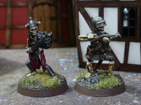 Two armoured skeleton warriors with sword, shield and crossbow respectively