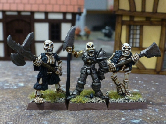 Three skeletal warriors with halberds and other polearms