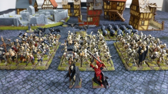 Regiments of undead creatures emerging from a destroyed town