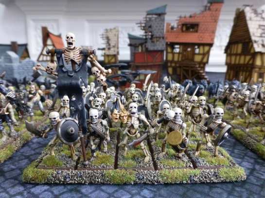 A regiment of skeletal warriors carrying heads and skulls as trophies