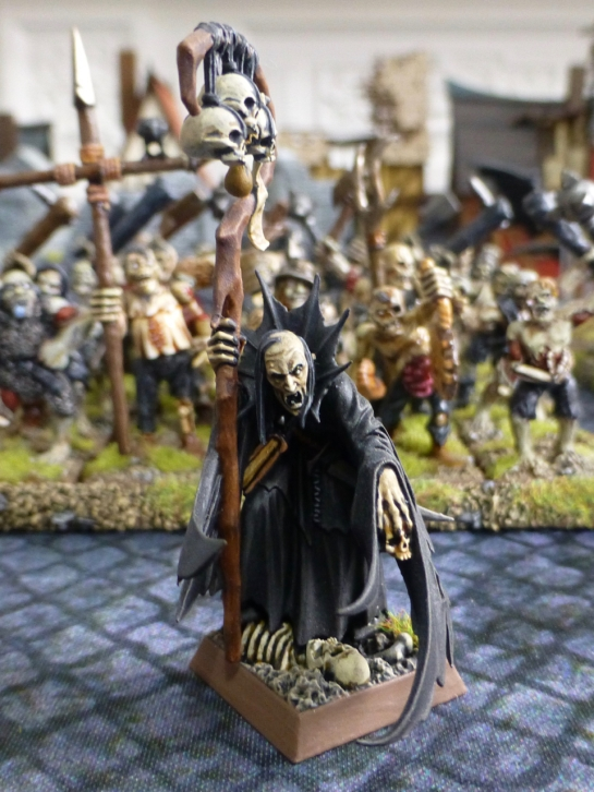 A scruffy looking necromancer in black robes