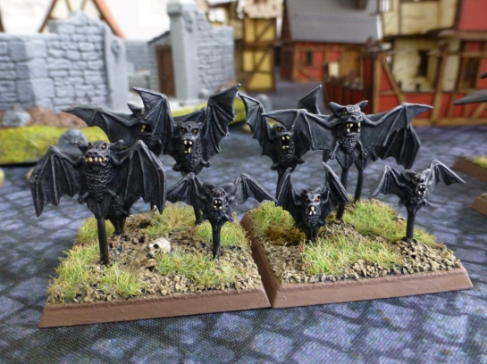 A swarm of black bats
