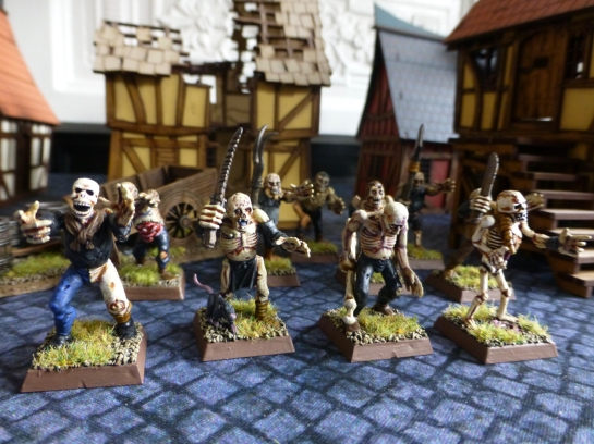 A loose group of zombies in a medieval town
