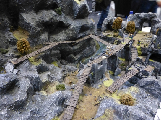 Fantasy skirmish game set in a craggy mountain landscape