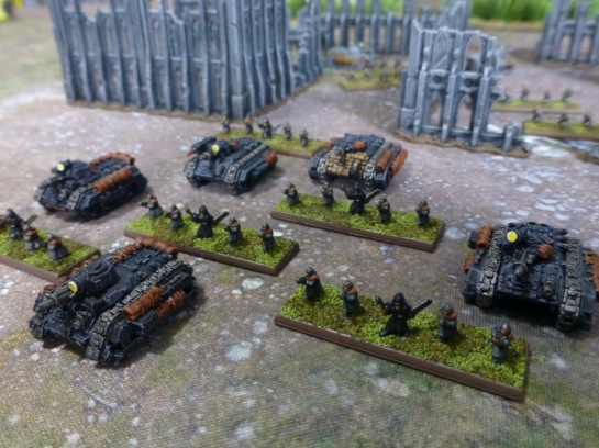 Five small scale infantry stands with armoured personnel carriers