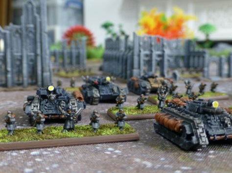 Close up view of infantry with Commissars and attached armoured vehicles