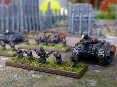 Stand of four soldiers, a Commissar and accompanying Chimera