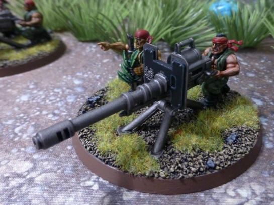 Heavy weapon team manning an autocannon