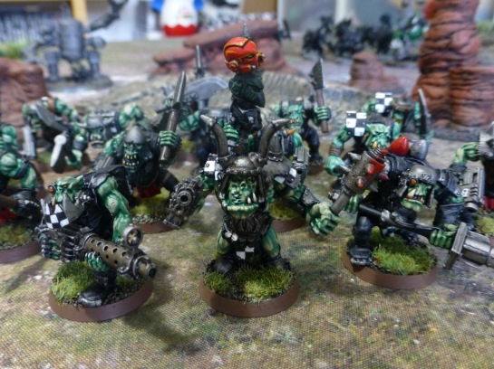 Large Ork with a back banner of Space Marine helmets on a spike