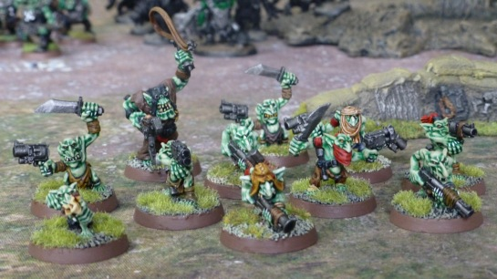 Ten Gretchin with a Runtherd on a battlefield