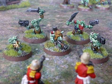 Five Gretchin attack soldiers of the Imperial Guard