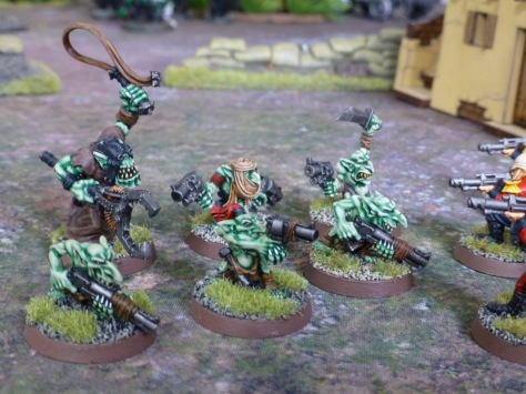 Runtherd driving his Gretchin towards Imperial Guardsmen