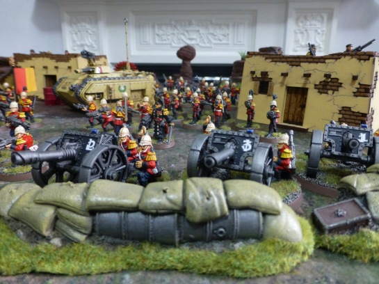 Lascannons on gun carriages behind sandbags