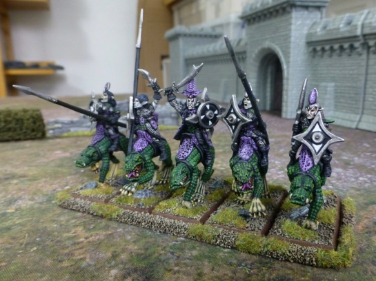Dark Elves on giant lizards carrying shields, lances and swords