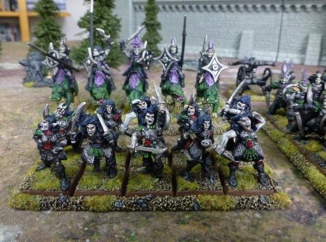 Ten frenzied female Dark Elves wielding sharp blades