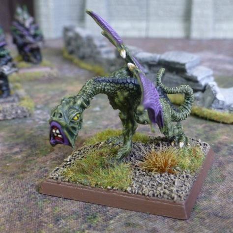 A green skinned Jabberwock with purple wings