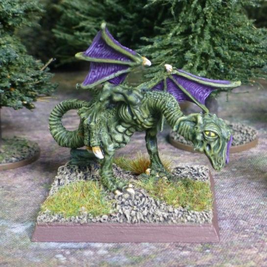 Green skinned Jabberwock with spread purple wings